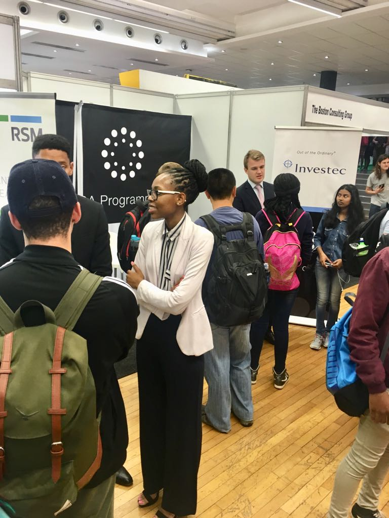 Investec stand with students